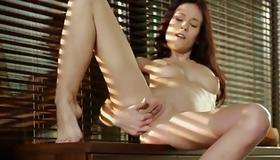 Sluttish woman is sexy rubbing her tits