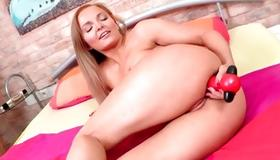 Passionate blonde slut self fucking her with dildo